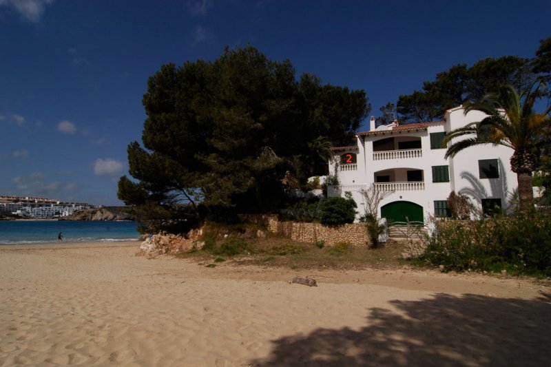 View towards the Jardín Playa apartments from s'Arenal d'en Castell, in Menorca.
