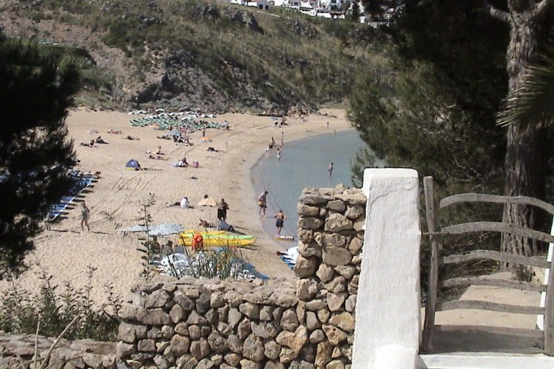 Beach of s'Arenal d'en Castell, in Menorca. View from the Jardín Playa apartments.