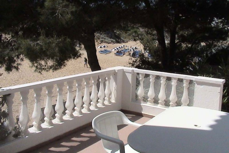Terrace overlooking the sand of s'Arenal d'en Castell in Menorca.