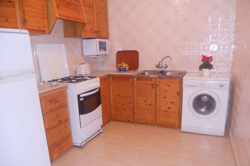 Kitchen and laundry of the apartment Jardín Playa 3.