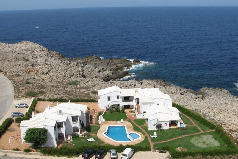 View of the Rocas Marinas apartments from the air, on the coast of Menorca.