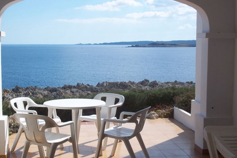 Views of the sea and coast of Menorca from the terrace of the Rocas Marinas 2A apartment.
