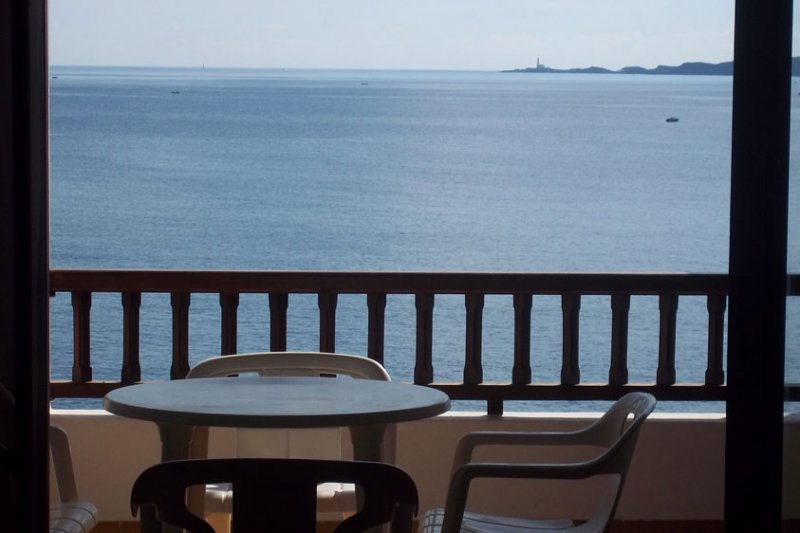 View from the terrace to the sea and coast of Menorca, in the Rocas Marinas 4A apartment.