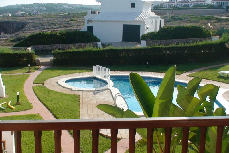 View from the balcony of the apartment Rocas Marinas 5 towards the swimming pool and the lawn of the