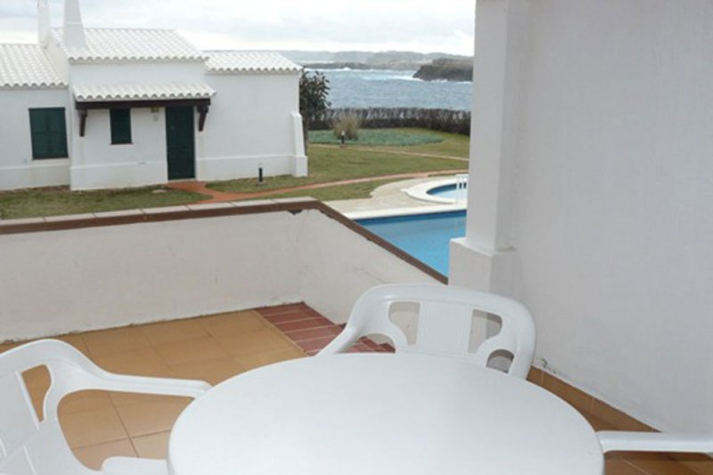 Terrace of the Rocas Marinas 6 apartment with stairs to the pool.