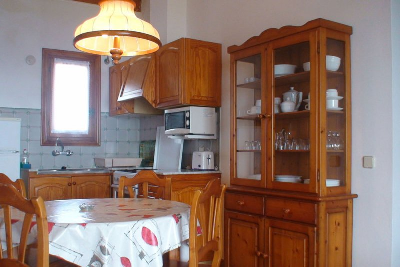 Part of the kitchen and dining room of the Rocas Marinas 8A apartment.