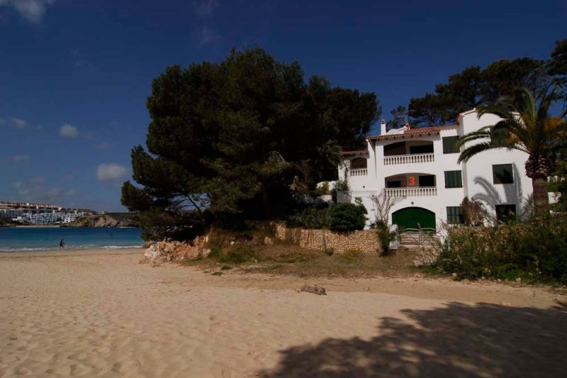View to the apartments Jardín Playa from one of the beaches of Menorca, s'Arenal d'en Castell.