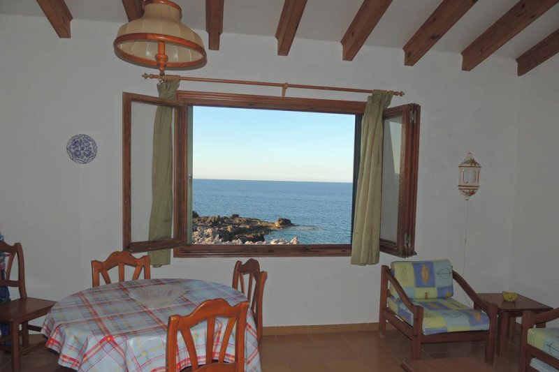 Window that overlooks the coast of Menorca from the Rocas Marinas apartments.