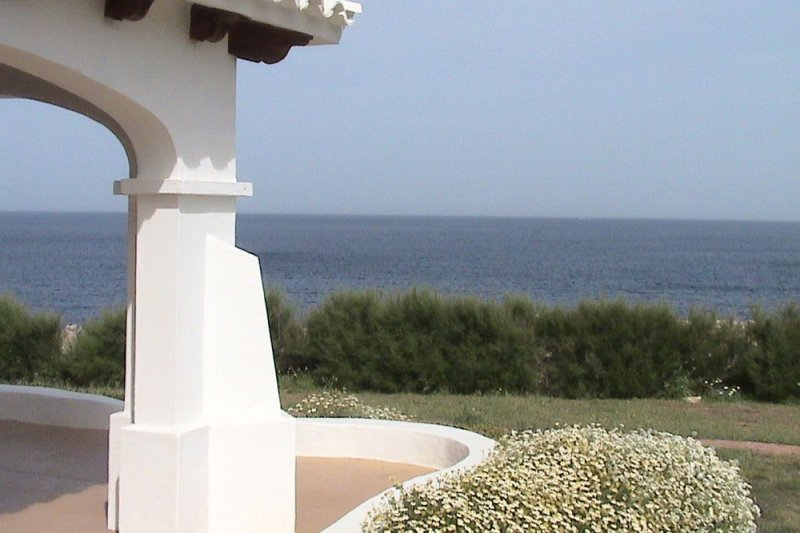 Views from the terrace of the apartment Rocas Marinas 1 towards the quiet sea of Menorca.