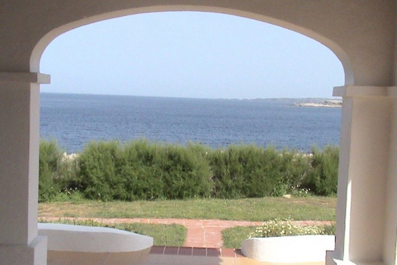 Decoration of the terrace with views of the sea and the coast of Menorca.