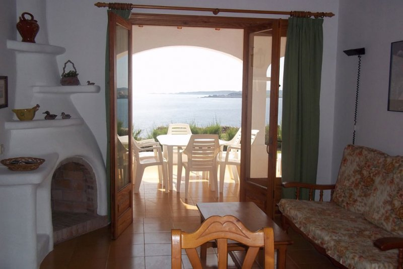 View to the terrace of the Rocas Marinas 1 apartment from the living room.
