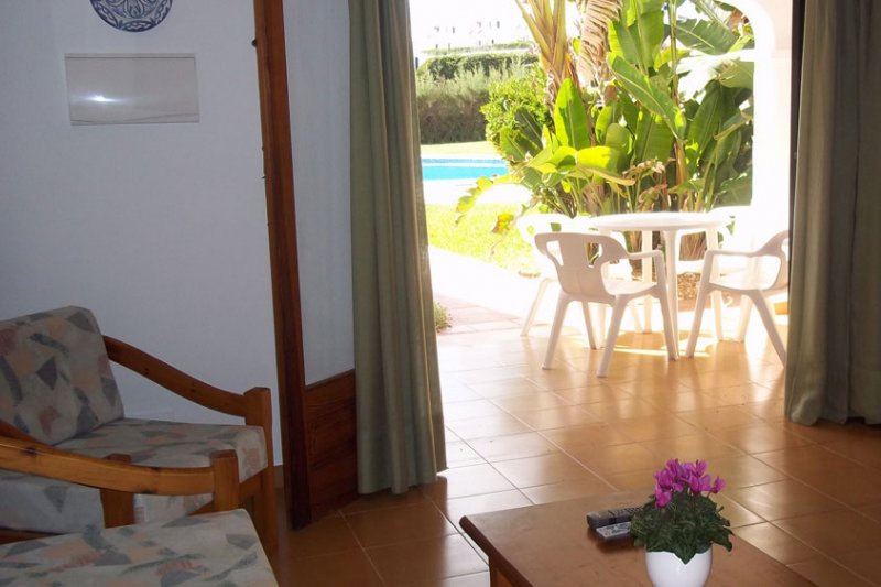 Living room of the Rocas Marinas 3 apartment with access to the terrace of the same.