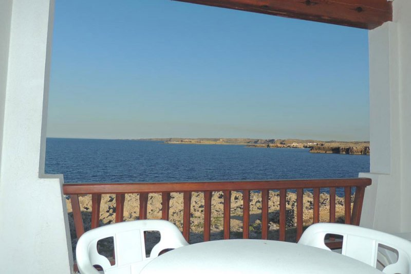 Views from the terrace of the apartment Rocas Marinas 4R to the coast of Menorca and the sea.