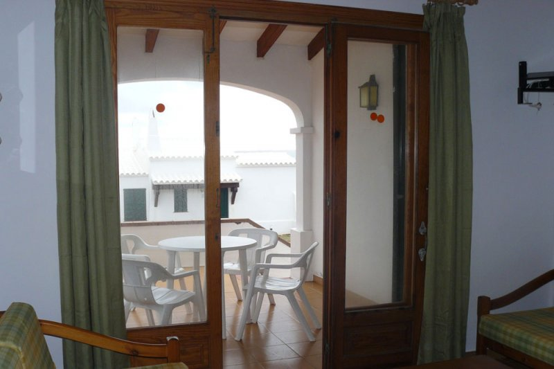 Access door to the terrace of the Rocas Marinas apartment 6.