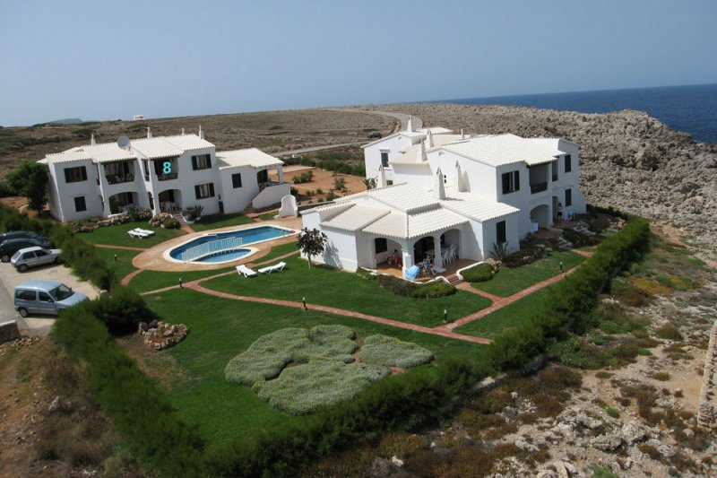 The apartment complex Rocas Marinas from above and with the coast of Menorca in the background.