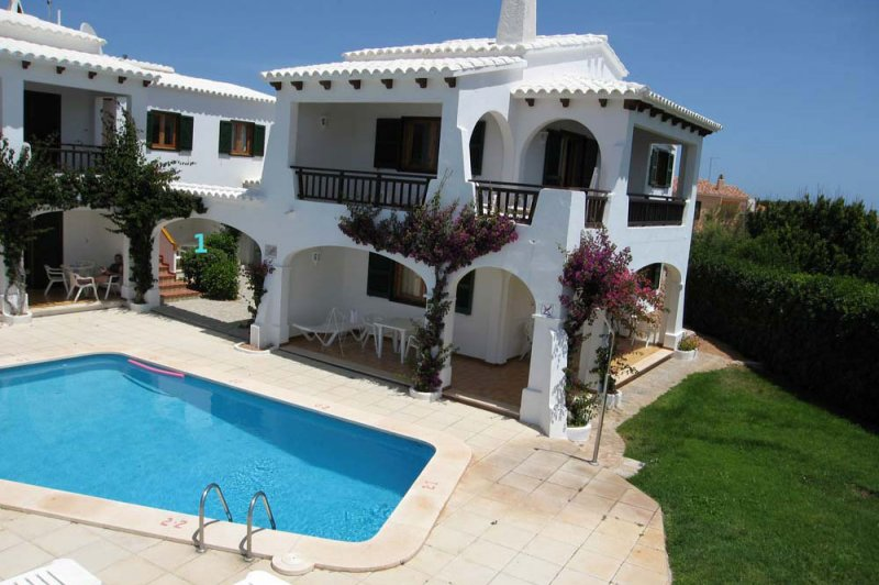 The Arco Iris apartments have a communal pool and incredible views of Menorca.