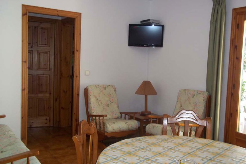 Part of the living room of the Arco Iris 1 apartment with entrance to the bedrooms and the terrace d