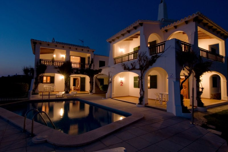 Night lighting of Arco Iris apartments, a summer night in Menorca.