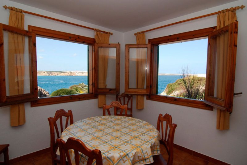 Part of the living room of the Arco Iris 5 apartment with windows with good views of the coast of Me
